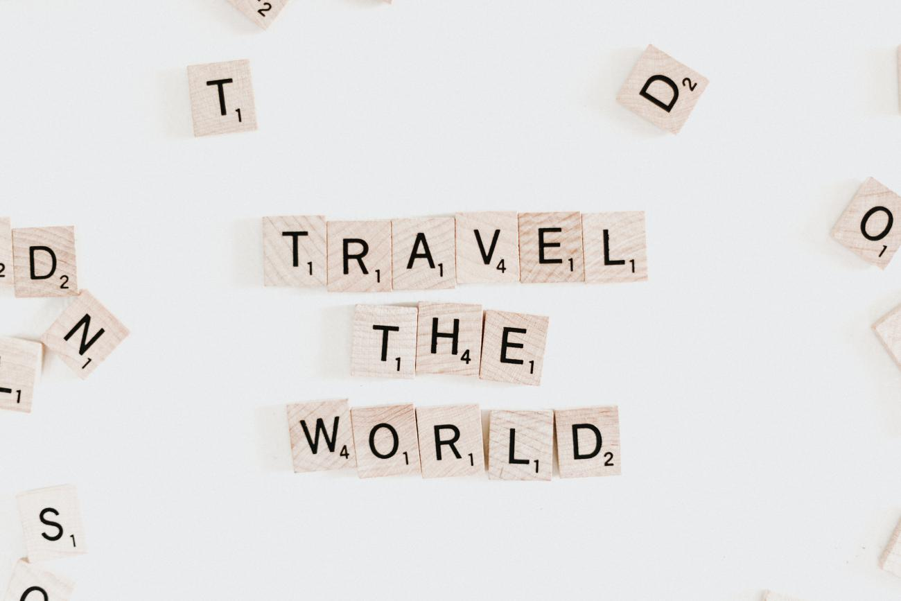 "Scrabble tiles spelling, ""Travel The World"" by Priscilla du Preez"