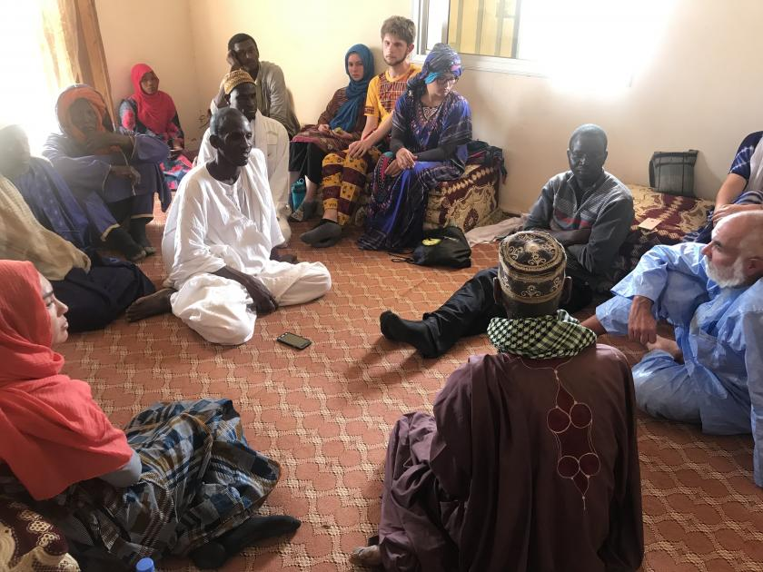 people sitting on the floor in a circle in Senegal
