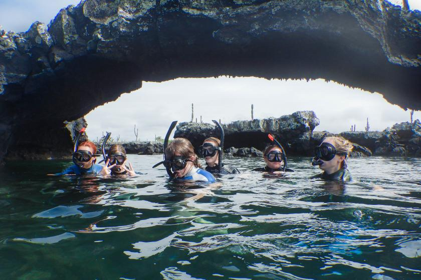 Students in the water snorkeling in Ecuador