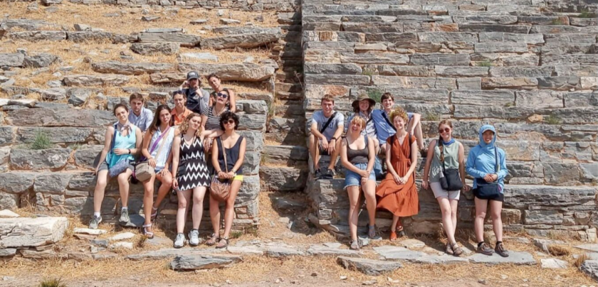 Group of 16 students and faculty in Greece